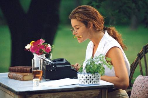 Woman with typewriter on an outdoor desk