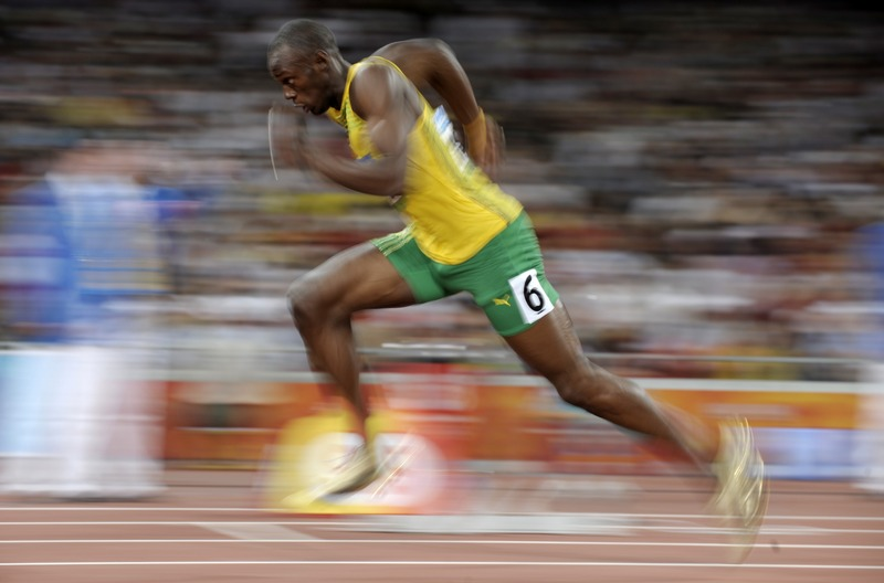 Jamaica's Usain Bolt starts a men's 200-meter semi-final during the athletics competitions in the National Stadium at the Beijing 2008 Olympics in Beijing, Tuesday, Aug. 19, 2008. (AP Photo/Thomas Kienzle)